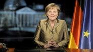 Bundeskanzlerin Angela Merkel bei ihrer Neujahrsansprache 2011 © dpa