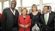 Heidi Klum und Seal mit Angela Merkel © picture-alliance/ dpa