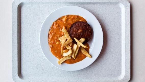 Ein typisches Mensa-Gericht in Gelb- und Brauntönen. © georghundt / photocase.de Foto: georghundt