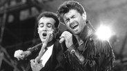 """Das britische Pop-Duo """"Wham"""", Andrew Ridgeley und George Michael © picture-alliance / dpa"""