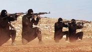 Maskierte Militante in Raqqua, Syrien. © picture alliance / ZUMA Press Foto: Dabiq