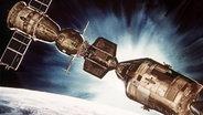 Zeichnung: Sojus-Kapsel dockt an Apollo-Raumschiff an. © picture-alliance / dpa