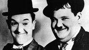 """Stan Laurel und Oliver Hardy als """"Dick und Doof"""". © picture-alliance / KPA"""
