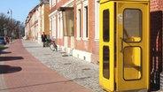 Gelbe Telefonzelle © dpa