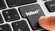 Die Enter Taste einer Computertastatur mit dem Tatort Logo © fotolia.com Fotograf: Stauke