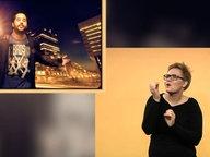 Laura M. Schwengber übersetzt ein Musikvideo in Gebärdensprache.